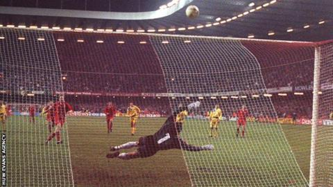 Paul Bodin strikes his penalty against the bar