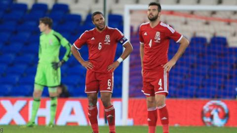 Wales captain Ashley Williams and Joe Ledley - who won his 50th cap - show their frustration at conceding a late equaliser against Finland