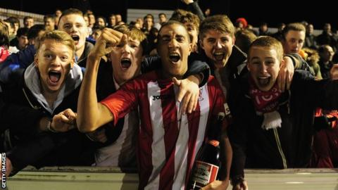 Brackley Town match-winner Glenn Walker celebrates beating Gillingham in the FA Cup