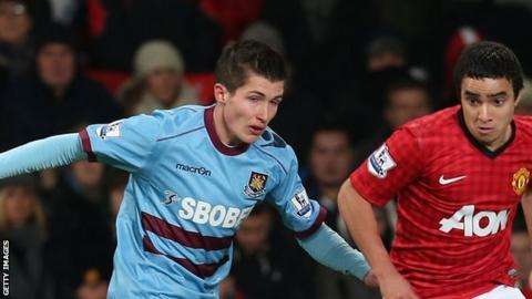 Dan Potts in action against Rafael Da Silva of Manchester United