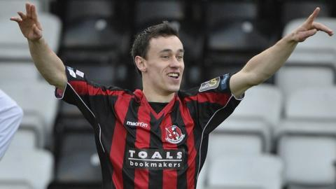 Crusaders Paul Heatley celebrates scoring against Coleraine at Seaview