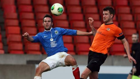 Andrew Waterworth and Gareth McKeown in action in the Premiership match at Windsor Park