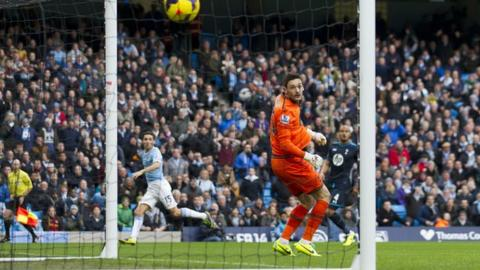 Jesus Navas (left) watches his chip beat Tottenham keeper Hugo Lloris which put Manchester City ahead after 14 seconds