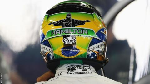 Lewis Hamilton carries an image of the Christ the Redeemer monument on his helmet