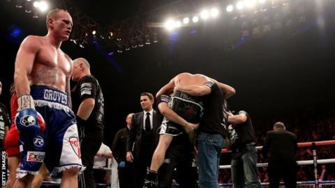 George Groves (left) looks on dejectedly as Carl Froch celebrates