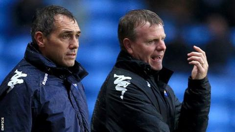 Andy Awford (right) with former Portsmouth manager Guy Whittingham.