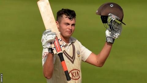 Dominic Sibley celebrates reaching his century for Surrey