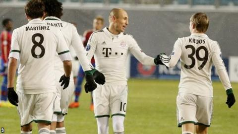 Bayern's Arjen Robben (centre) celebrates scoring the opening goal during the Champions League group D soccer match between CSKA Moscow and Bayern Munich