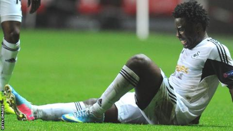 Wilfried Bony grimaces after injuring his hamstring