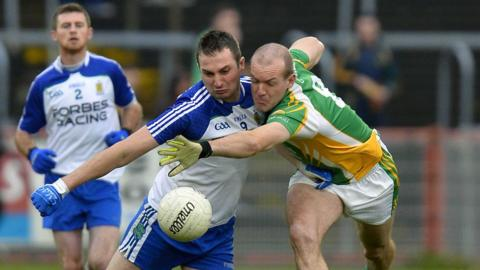 Ballinderry's James Conway and Glenswilly midfielder Neil Gallagher battle for possession in the Healy Park decider.