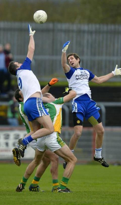 Ballinderry midfielder James Conway jumps highest to win the ball