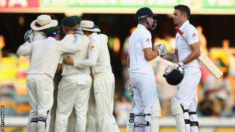 Joe Root and James Anderson shake hands after loosing the first test at the Gabba