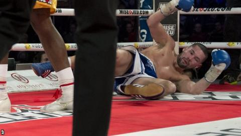Tony Bellew is knocked to the canvas by Adonis Stevenson