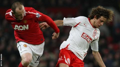 Wayne Rooney tussles with Sergio Torres at Old Trafford