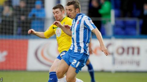 Hartlepool United's Michael Duckworth (right) and Coventry City's John Fleck (left) battle for the ball