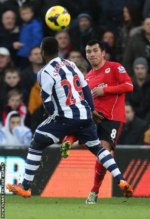 Cardiff City midfielder Gary Medel plays the ball past West Brom's Stephane Sessegnon