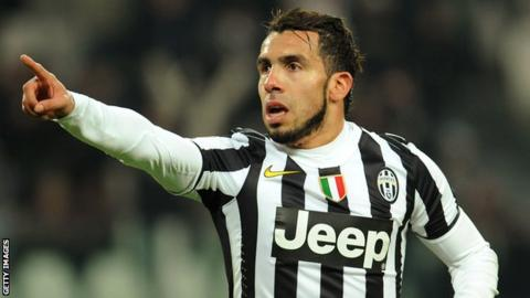 Juventus striker Carlos Tevez celebrates after scoring against Sassuolo