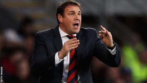 Cardiff City manager Malky Mackay gesticulates to his players from the touchline