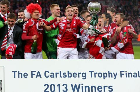 Wrexham's first Wembley appearance ended in triumph as they beat Grimsby Town on penalties to win the FA Trophy.