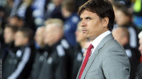 Wales manager Chris Coleman ended speculation about his future by signing a new contract with the Football Association of Wales.