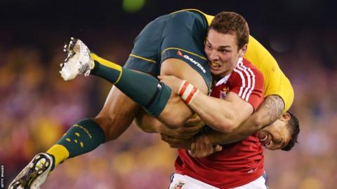 British and Irish Lions wing George North carries Australia wing Israel Folau during the second Test, a match which the tourists lost 16-15.