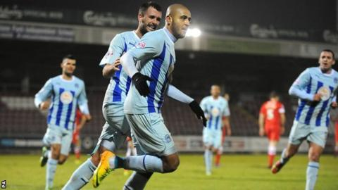 Coventry City's Leon Clarke (front) celebrates with Dan Seabourne (back left) after scoring the second goal of the game against Hartlepool United