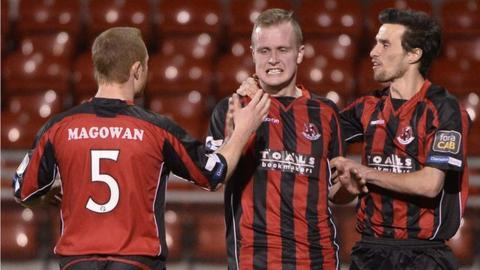 Crusaders Jordan Owens celebrates scoring the extra-time winner against Ballymena United