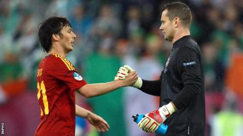 Shay Given with Spain's David Silva after the Republic's 4-0 Euro 2012 defeat by Spain