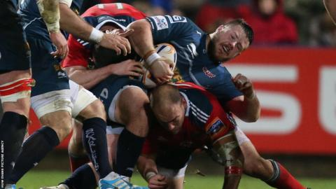 Rob Evans of the Scarlets is stopped by the Munster defence during his side's 16-10 defeat in Ireland