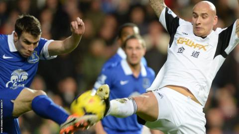 Everton's Seamus Coleman battles for the ball with Swansea's Jonjo Shelvey of Swansea City in their Premier League
