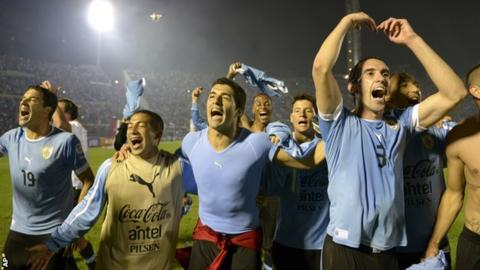 Uruguay players Andres Scotti, Walter Gargano, Luis Suarez and Diego Godin celebrate qualifying for the 2014 World Cup after beating Jordan in the play-off in Montevideo