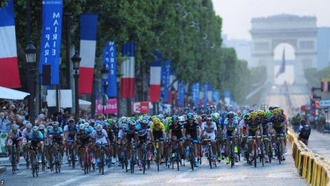 Wearing the leader's yellow jersey, Chris Froome takes up a spot in the centre of the peloton during the final stage of the 2013 Tour de France. The Briton completes victory in Paris to emulate the success of countryman Sir Bradley Wiggins.
