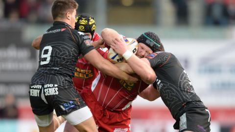 Samson Lee runs into strong Ospreys defence in the early stages of the Boxing Day derby at Parc Y Scarlets