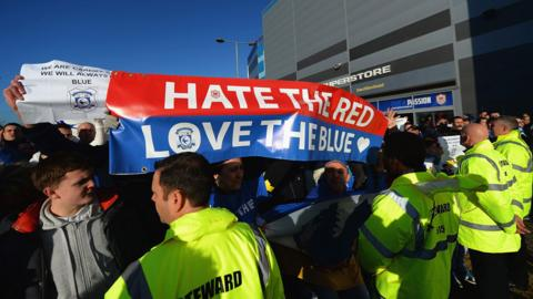 A large group of Cardiff City fans make their feelings about owner Vincent Tan clear during a protest before the home game against Southampton