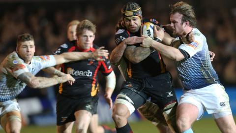 Dragons flanker Netani Talei is tackled by Blues try-scorer Kristian Dacey during the first half of the Boxing Day derby match at Rodney Parade