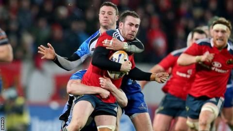 JJ Hanrahan is tackled by Eoin Griffin as Robbie Henshaw lurks in the background