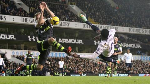 Tottenham striker Emmanuel Adebayor's volley was handled by Stoke defender Ryan Shawcross leading to a Spurs penalty