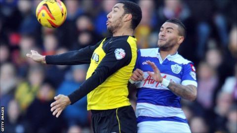 Watford's Troy Deeney and QPR's Danny Simpson