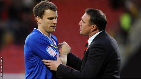 Cardiff City defender Ben Turner with former manager Malky Mackay
