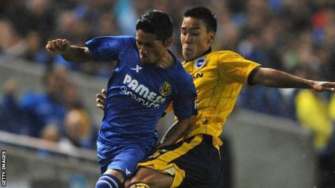 Adam Chicksen (r) tackles Javier Aquino of Villarreal