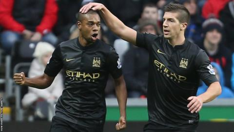 Manchester City's Fernandinho celebrates with Matija Nastasic after putting his side 1-0 up at Swansea City in the Premier League