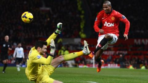 Tottenham goalkeeper Hugo Lloris's challenges Manchester United's Ashley Young