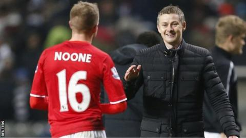 Cardiff manager Ole Gunnar Solskjaer congratulates Craig Noone after his goal at Newcastle