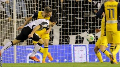 Helder Postiga heads in Valencia's equaliser