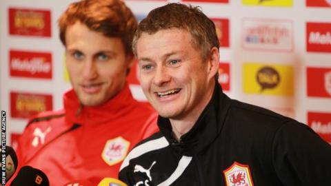 Cardiff City's Magnus Wolff Eikrem and Ole Gunnar Solskjaer