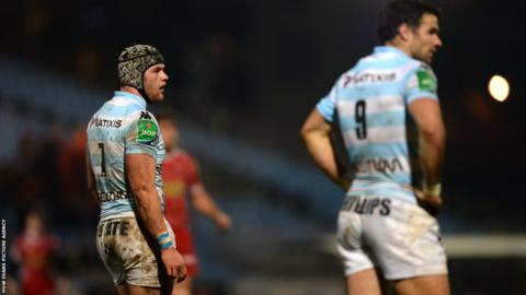 Racing Metro's Wales and Lions duo Dan Lydiate and Mike Phillips can only watch as the Scarlets record a famous victory against them in Paris