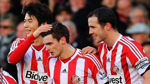 Adam Johnson mobbed Fulham v Sunderland