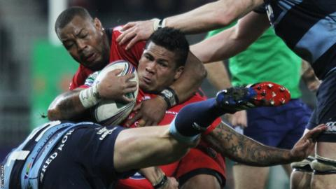 Leigh Halfpenny puts his body on the line as David Smith attacks for Toulon in the Heineken Cup against Cardiff Blues