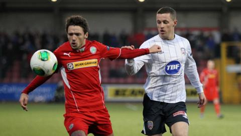 Cliftonville's Tomas Cosgrove is pursued by Ruairi Harkin of Coleraine at Solitude