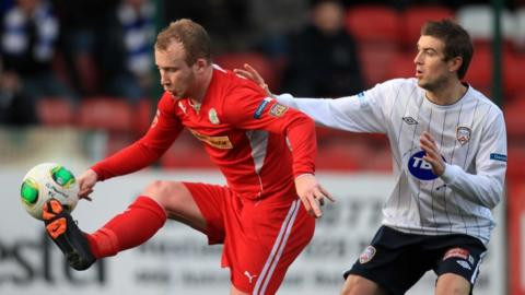 Liam Boyce holds off the challenge of Steven Douglas as Cliftonville draw 2-2